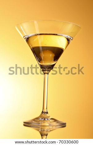 Martini glass on yellow background