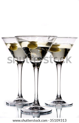 Martini glass with olive inside - stock photo