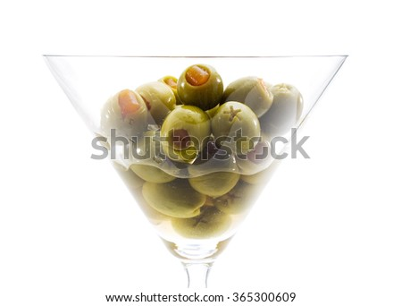 Martini Glass with Olives isolated on white background