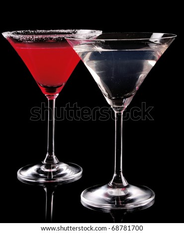 Martini glass with red coctail and with vodka on black background - stock photo