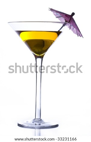 martini glass with yellow drink - stock photo