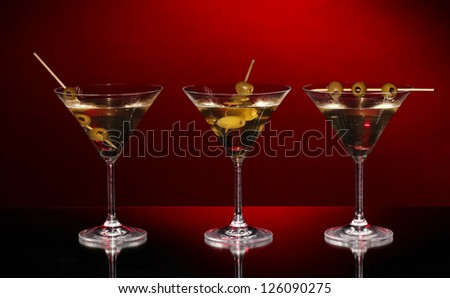 Martini glasses on dark background - stock photo