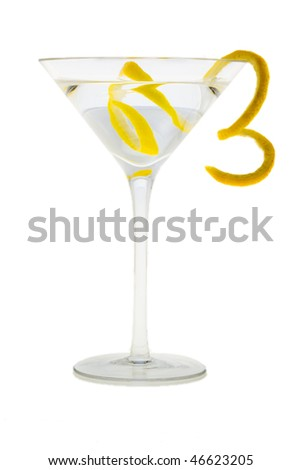 Martini mixed drink with lemon peel garnish on a white background - stock photo