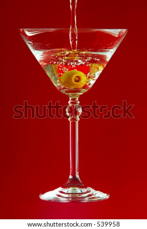 martini on red background - stock photo