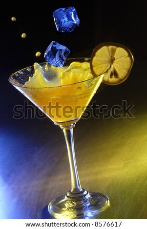 martini splash and ice - stock photo