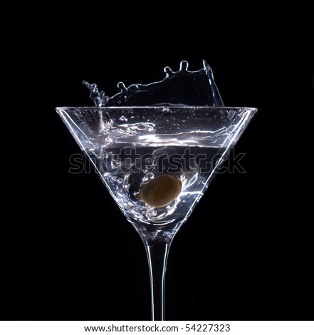 Martini splash on black background