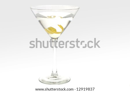Martini with a lemon twist, studio shot against white, back lit. - stock photo