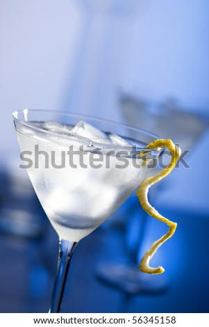 Martini with lemon peel and condensation on glass - stock photo