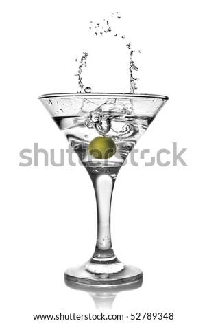 martini with olive and splash isolated on white - stock photo
