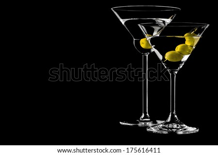 Martini with olives on a black background - stock photo
