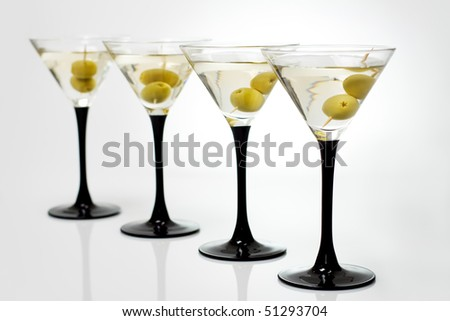 Martini with olives on a white background - stock photo