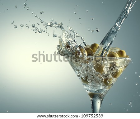 Martini with olives on gradient background - stock photo