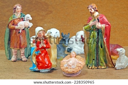 Mary and Joseph with the child Jesus in the manger with  some animals - stock photo