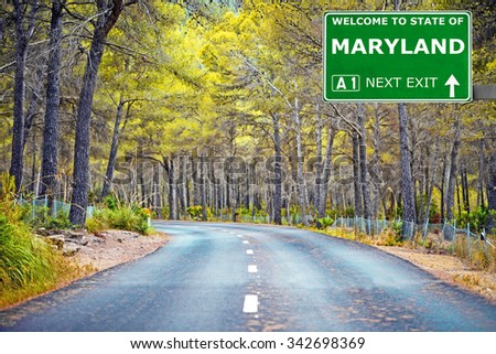 MARYLAND road sign against clear blue sky - stock photo
