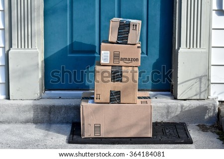 MARYLAND, USA - January 18, 2016: Image of an Amazon package. Amazon is the largest Internet-based retailer in the United States. - stock photo