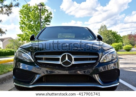 MARYLAND, USA - MAY 7, 2016: A black Mercedes Benz C400. Mercedes Benz is a luxury car dealer and manufacturer.  - stock photo