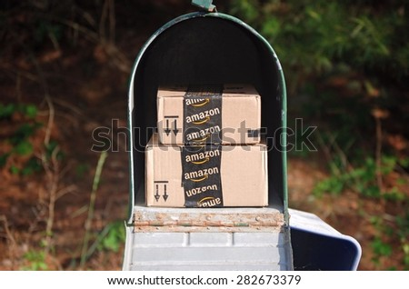 MARYLAND, USA - MAY 29, 2015: Image of an Amazon packages. Amazon is an online company and is the largest retailer in the world. - stock photo