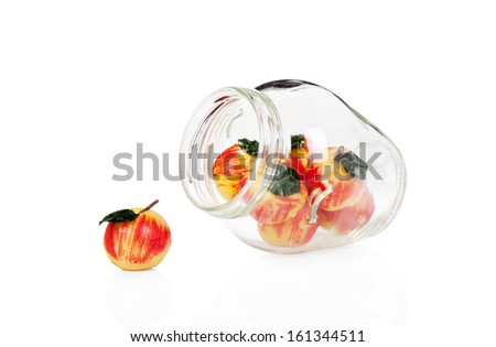 Marzipan apples in a glass jar isolated on white background - stock photo