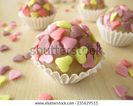 Marzipan pralines with sugar hearts - stock photo