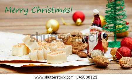 Marzipan traditional sweets christmas card with written Merry Christmas greetings - stock photo