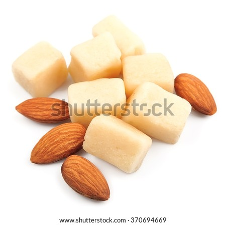 Marzipan with almonds on white background - stock photo