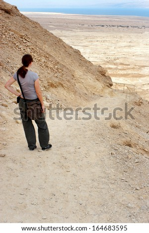 MASADA,ISR - OCT 21:Visitor climbing up Masada Fortress in Israel by using the steep ancient snake path on Oct 21 2006.Masada considered as one of the most popular tourist destination in Israel. - stock photo