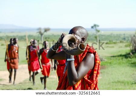 Masai Kudu Horn Blowing - Kenya - stock photo
