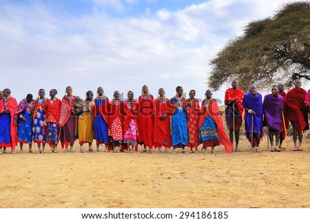 MASAI MARA, KENYA - AUG 23, 2010: Group of unidentified African people from Masai tribe prepare for traditional Jump dance in a local village near Masai Mara National park