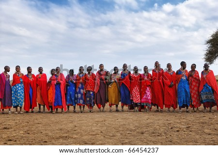MASAI MARA, KENYA - AUGUST 23: Group of unidentified African women from Masai tribe prepare for traditional Jump dance on August 23, 2010 in a local village near Masai Mara National park. - stock photo