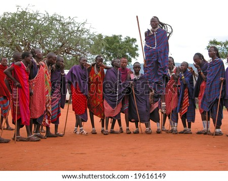 MASAI VILLAGE - DECEMBER 01: Massai welcome dance - village (museum) for tourists, in the vicinity of Mombasa - about 100 km -  road towards the Tsavo East National Park - December 01, 2007 in Kenya - stock photo