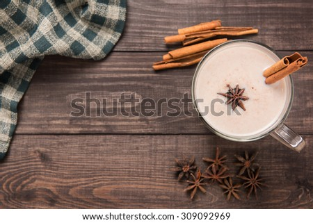 Masala chai with spices cinnamon , cardamom, ginger, clove and star anise on wooden background. - stock photo