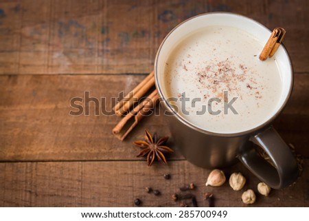 masala chai with spices. Cinnamon Stick, Thai Cardamom, Ginger, Clove, Star Anise, Black Peppercorns, Fennel Seeds, Black Tea - stock photo