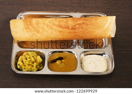 Masala Dosa with Chutney and Sambaar, Traditionally a South Indian Dish - stock photo