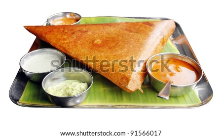 Masala dosa with different types of chutney and sambar. This is a closeup shot of one of the most famous indian snack. - stock photo