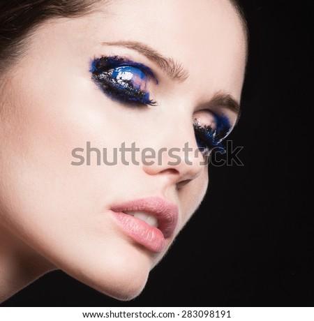 Mascara Applying. Long Lashes closeup. Mascara Brush. Eyelashes extensions. Makeup for Blue Eyes. Eye Make up Apply - stock photo