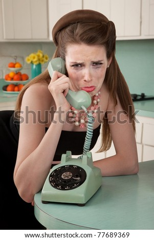 Mascara smeared housewife crys on phone in a retro-style scene - stock photo