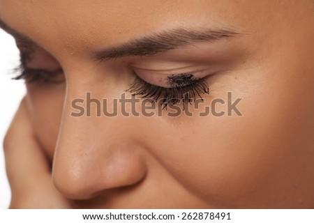Mascara smudged on the eyelid. Make up concept - stock photo