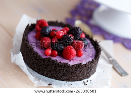 Mascarpone cottage cheese cake decorated with berries - stock photo