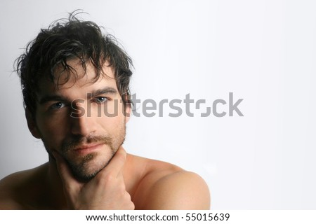 Masculine attractive young shirtless man with beard against white background - stock photo