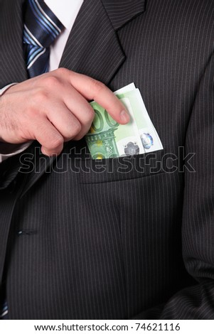 masculine hand, taking away money in the pocket of coat - stock photo