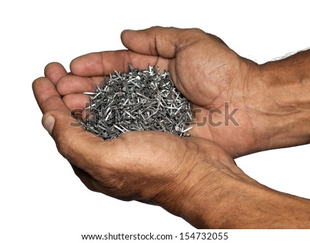 Masculine hands carrying a heap of nails isolated on a white background - stock photo