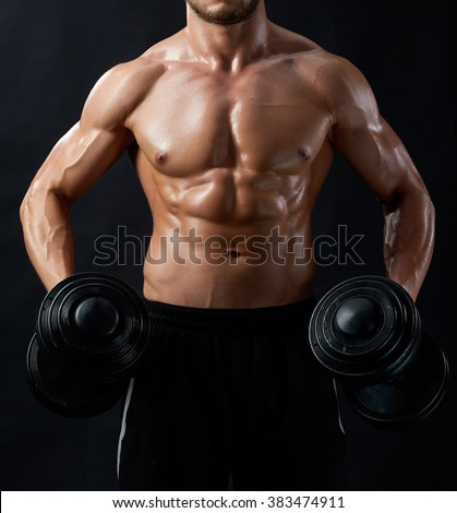 Masculinity to show. Vertical shot of a young muscular man showing off his toned body