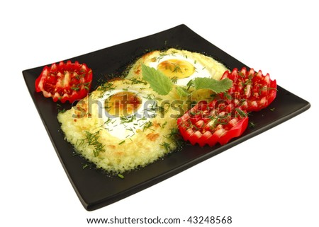 mash and eye eggs on dish over white - stock photo