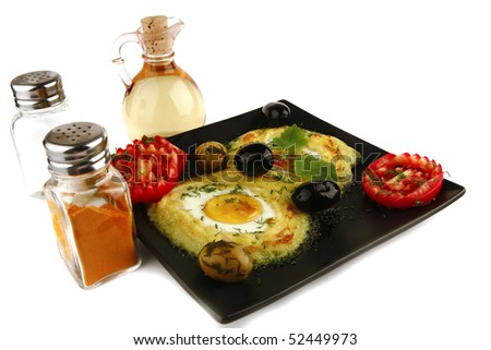 mash served with eye eggs and spices - stock photo