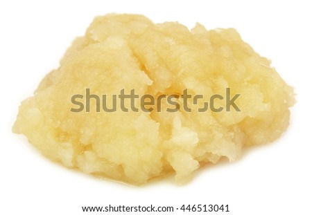 Mashed garlic over white background