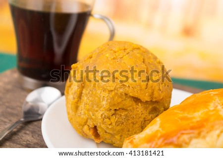Mashed green banana in a circle form, behind coffee  - stock photo
