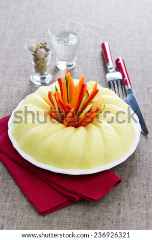 mashed potato cauliflower on a plate with vegetable sticks in the center of carrots cucumber pepper - stock photo