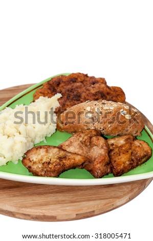 Mashed potato chicken breasts zucchini meatballs cereals bread. - stock photo
