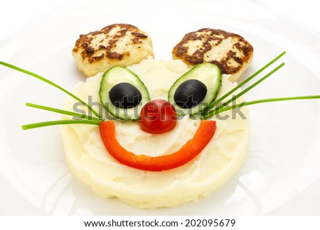 mashed potatoes and cakes in the shape of a mouse - stock photo