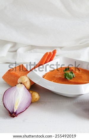 Mashed potatoes carrots with onion and pumpkin on white wooden table - stock photo